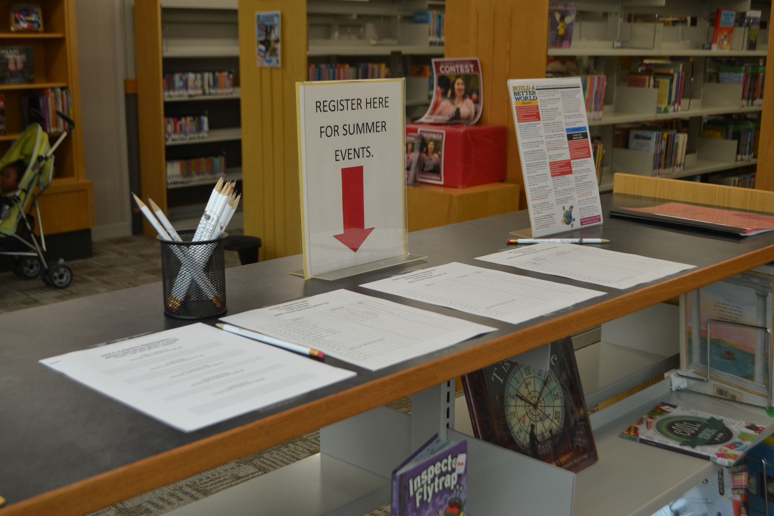 Summer Reading Event Registration Table with sign up pages